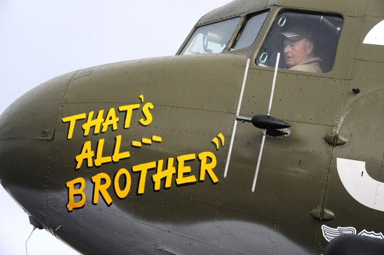 Pilot Tom Travis sits in the cockpit of That's All, Brother