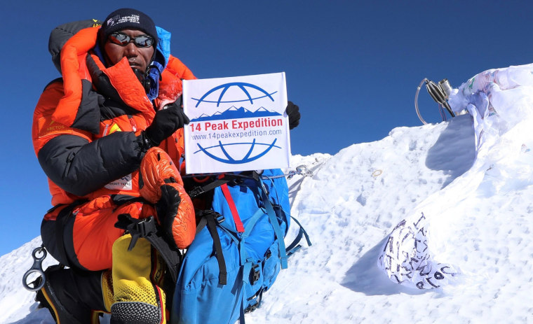Image: Nepali mountaineer Kami Rita Sherpa posing at the top of Mount Everest after summiting it for the 23rd time
