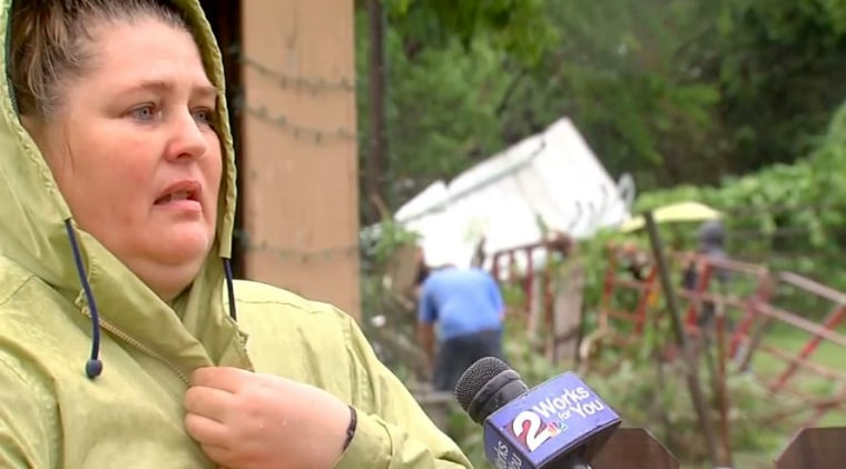 Image: Lisa Watson speaks to a reporter after surviving a storm in Tulsa, Oklahoma.