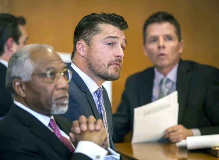 Iowa farmer and former TV reality show celebrity Chris Soules, center, listens during a hearing in court in Independence, Iowa, on Nov. 27, 2017.