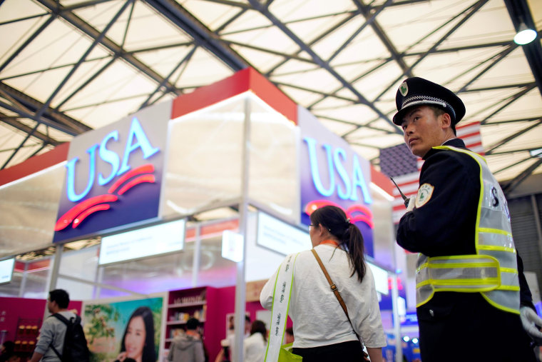 Image: A security officer keeps watch at U.S. food booths at SIAL food innovation exhibition, in Shanghai