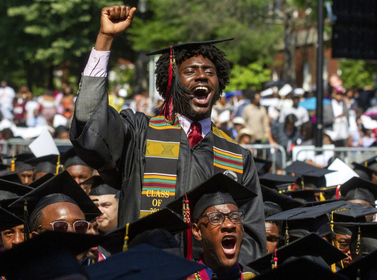 Image: Graduates celebrate after philanthropist Robert F. Smith said he would provide money to cancel the graduating classes student loan debt at Morehouse College in Atlanta on May 19, 2019.