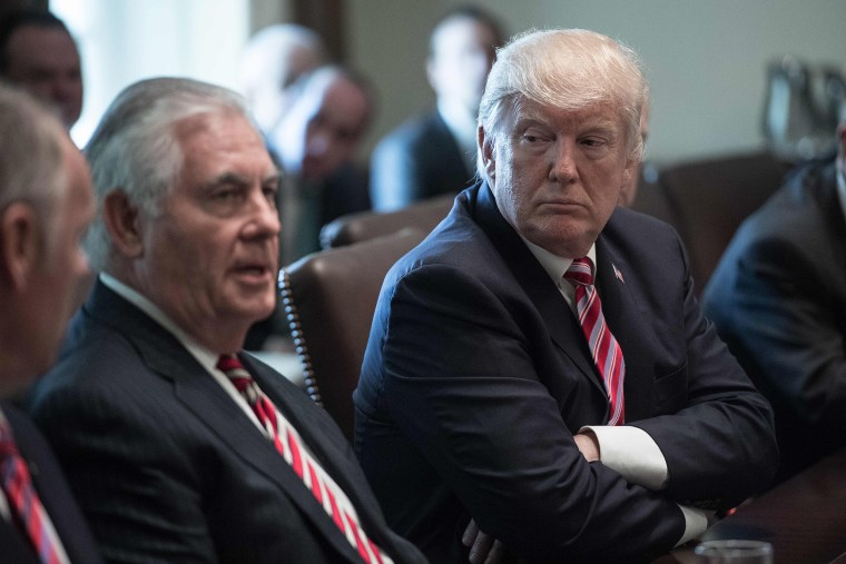Image: President Donald Trump listens to Secretary of State Rex Tillerson speak during a cabinet meeting at the White House