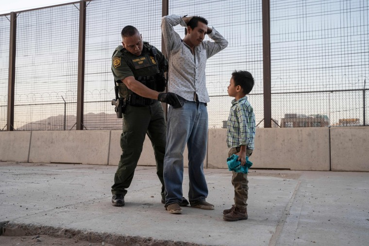 Jos?, 27, with his son Jos? Daniel, 6, is searched by U.S. Customs and Border Protection Agent Frank Pino on May 16, 2019, in El Paso, Texas.
