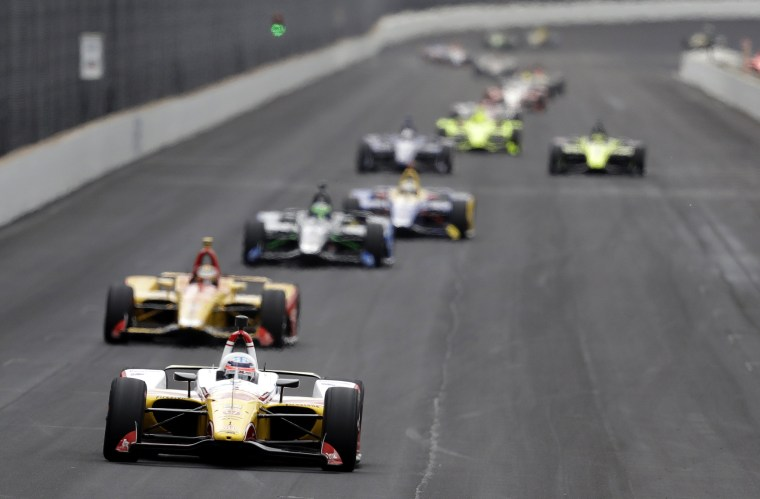 Image: Cars race during a practice for the Indianapolis 500 IndyCar race on May 20, 2019.