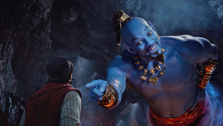 "Aladdin, played by Mena Massoud, meets the larger-than-life blue Genie, Will Smith, in Disney's live-action adaptation ""Aladdin,"" directed by Guy Ritchie."