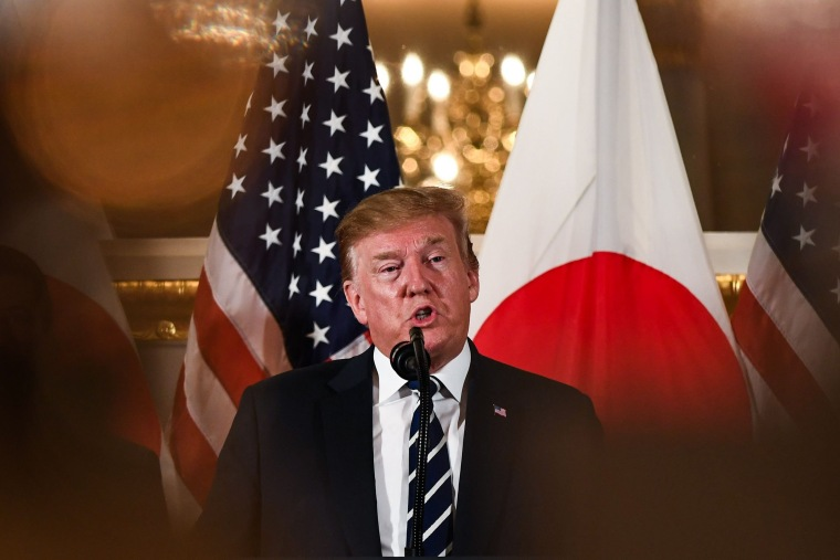 Trump arrives in Japan with Sumo wrestling and golf on the agenda