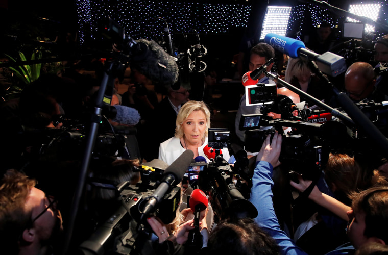 Image: French far-right National Rally (Rassemblement National) party leader Marine Le Pen talks to the media after the first results in Paris
