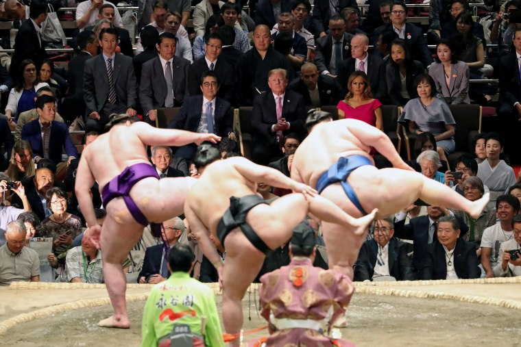 Image: President Donald Trump, first lady Melania Trump, Japanese Prime Minister Shinzo Abe and wife Akie Abe watch the Summer Grand Sumo Tournament at Ryogoku Kokugikan Sumo Hall in Tokyo