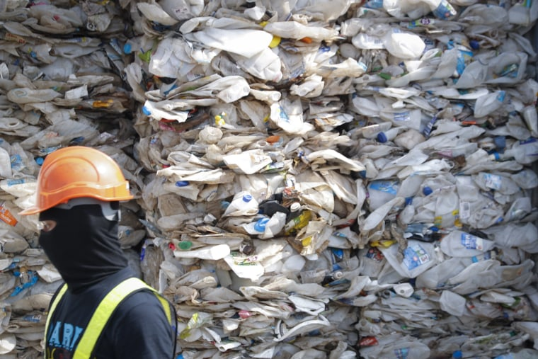Image: A container is filled with plastic waste from Australia, in Port Klang, Malaysia