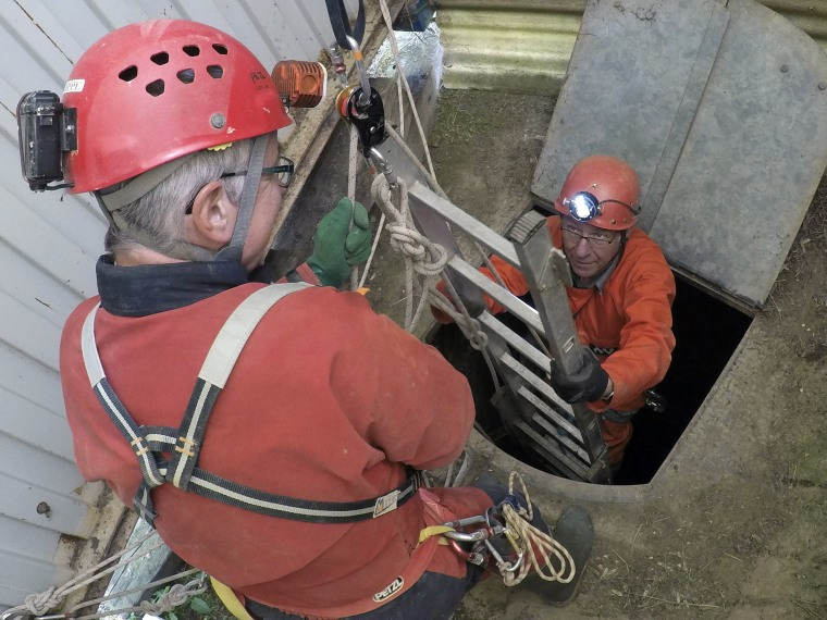 Image: Spelunker Philippe Poisson, left, and Laurent Dujardin exit a quarry in Fleury-sur-Orne, near Caen, Normandy.