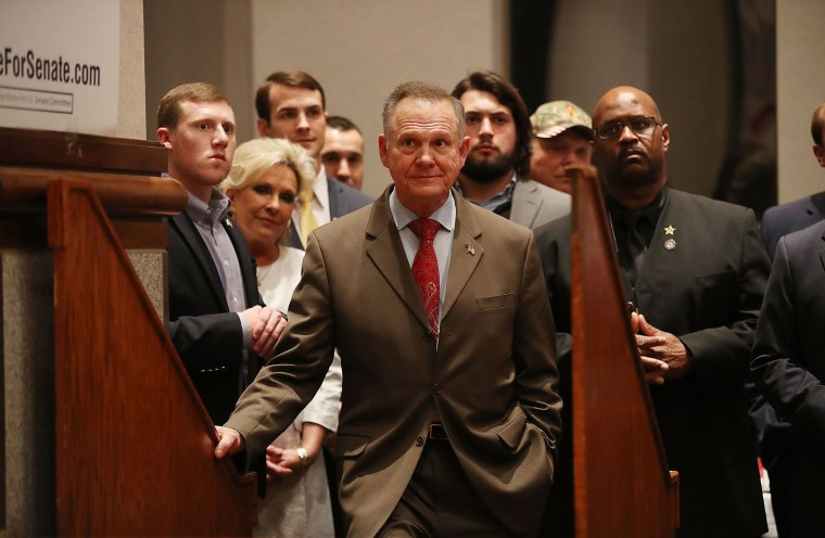 Image: Republican Senatorial candidate Roy Moore waits to be introduced to speak about the race against his Democratic opponent Doug Jones.