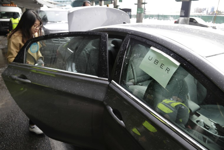 Image: A passenger enters an Uber car at LaGuardia Airport in New York