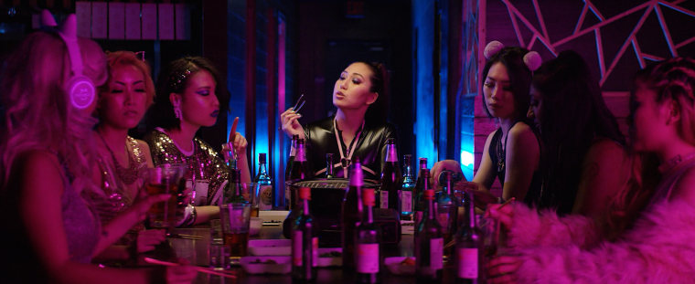"Jenny Ly appears as ""Arigato Grande"" in a parody video of Ariana Grande's hit, ""7 rings."""