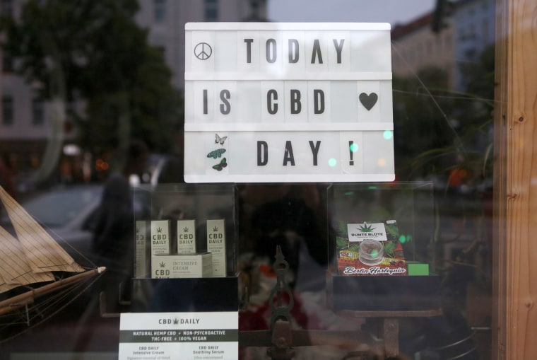 Image: CBD (Cannabidiol) hemp oil products are seen for sale in a shop window