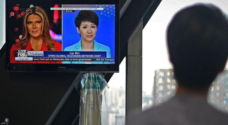 Image: CHINA-US-TRADE-MEDIA-POLITICS