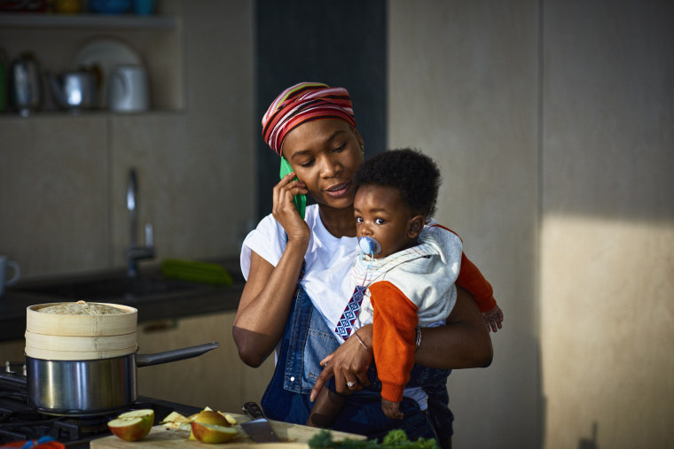 Woman with baby son in kitchen