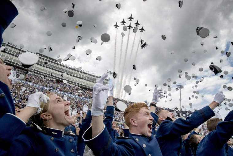 Image: The Thunderbirds fly overhead as United States Air Force Academy cadets toss their hats in the air during their graduation ceremony at Falcon Stadium on May 30, 2019, in Colorado Springs.