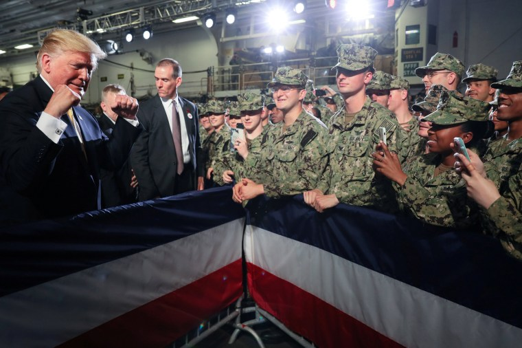 Image: U.S. troops take photos of U.S. President Trump aboard the USS Wasp in Yokosuka