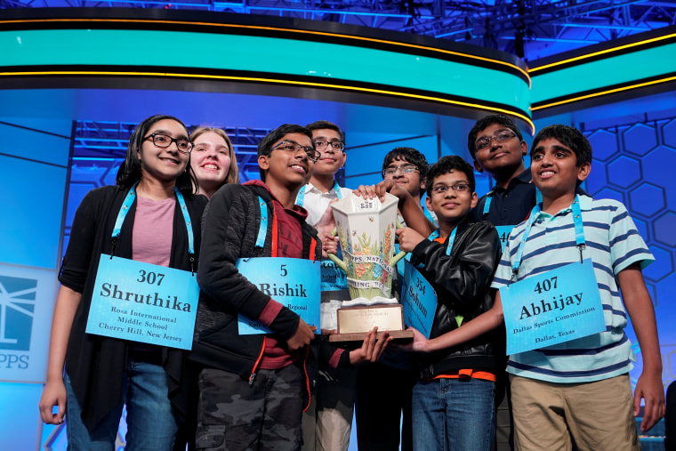 Image: Champions in an eight-way tie celebrate after the final round of the 92nd annual Scripps National Spelling Bee in Oxon Hill, Maryland.