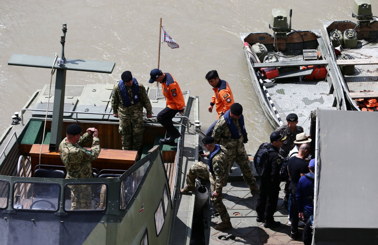 Image: A South Korean rescue team at the site of a ship accident, which killed several people, near Margaret Bridge on the Danube river in Budapest