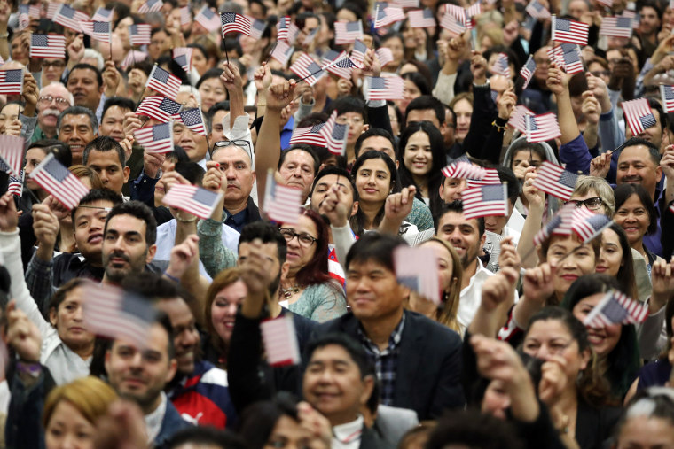 Image: Immigrants attend a naturalization ceremony to become new U.S. citizens in Los Angeles