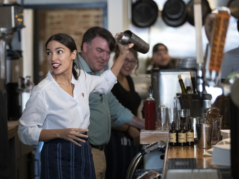 Image: Rep. Alexandria Ocasio-Cortez Bartends In Support Of Raise the Wage Act