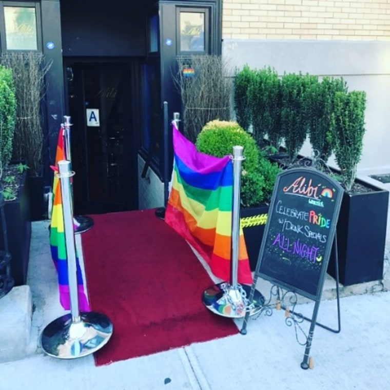 Pride flags on display outside Alibi Lounge in New York City.