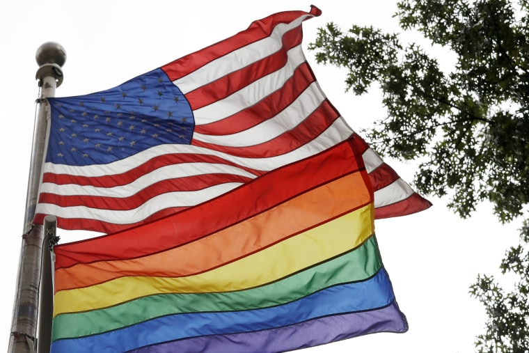 Image: The rainbow flag flies beneath the American flag