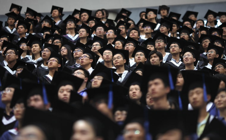 Image: Students attend their college graduation ceremony at Fudan University in Shanghai, China
