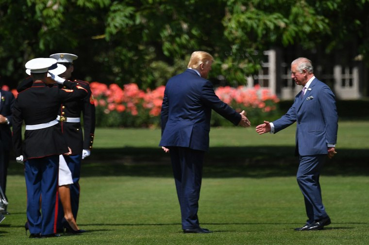 Image: Britain's Prince Charles, Prince of Wales greets President Donald Trump as he steps off Marine One to attend a welcome ceremony at Buckingham Palace