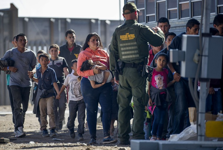 Image: Migrants are loaded onto a bus by Border Patrol agents in El Paso, Texas, on June 1, 2019.
