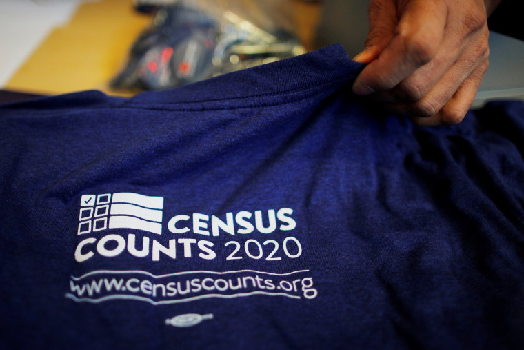 Image: T-shirts are displayed at a community activists and local government leaders event to mark the one-year-out launch of the 2020 Census efforts in Boston