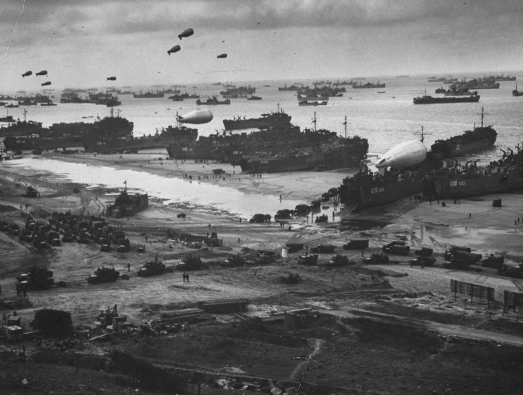 Image: A massive landing and deployment of U.S. troops, supplies and equipment on the day after the victorious D-Day action on Omaha Beach, Arromanches-les-Bains