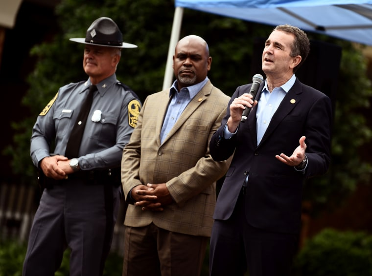 Image: Virginia Governor Ralph Northam speaks to mourners during a vigil for the victims of a shooting in Virginia Beach on June 2, 2019.