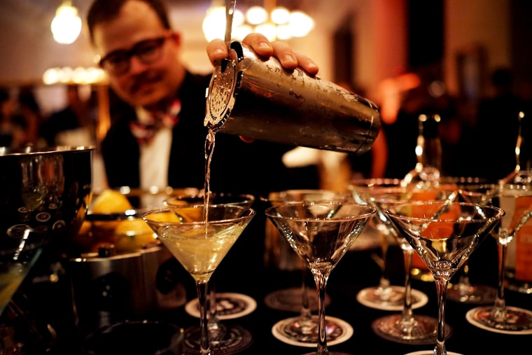 Image: A bartender pours drinks at an event at the New York Public Library on May 9, 2014.