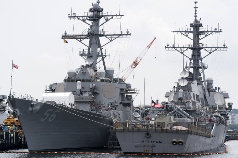 Image: The USS John S. McCain (DDG 56) destroyer, left, is moored in a dock at the Yokosuka Naval Base on June 1, 2019 in Yokosuka, Japan.