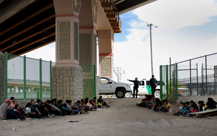 Image: Border Patrol agents watch over detained migrants near El Paso, Texas, on May 19, 2019.
