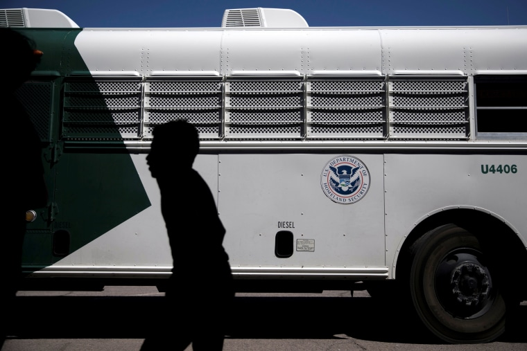Image: A migrant child disembarks a U.S. Border Patrol bus at the processing center and shelter in Deming