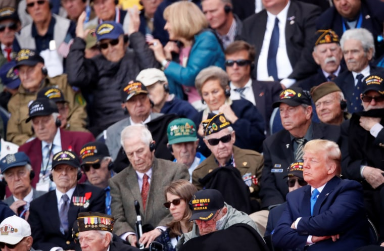 Image: President Donald Trump sits next to WWII veterans during a ceremony to mark the 75th anniversary of the D-Day at the Normandy American Cemetery and Memorial in Colleville-sur-Mer, France