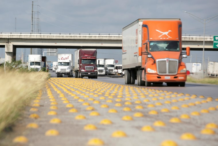 Image: Trucks are seen before arriving at a border customs control to cross into U.S. at the World Trade Bridge in Nuevo Laredo