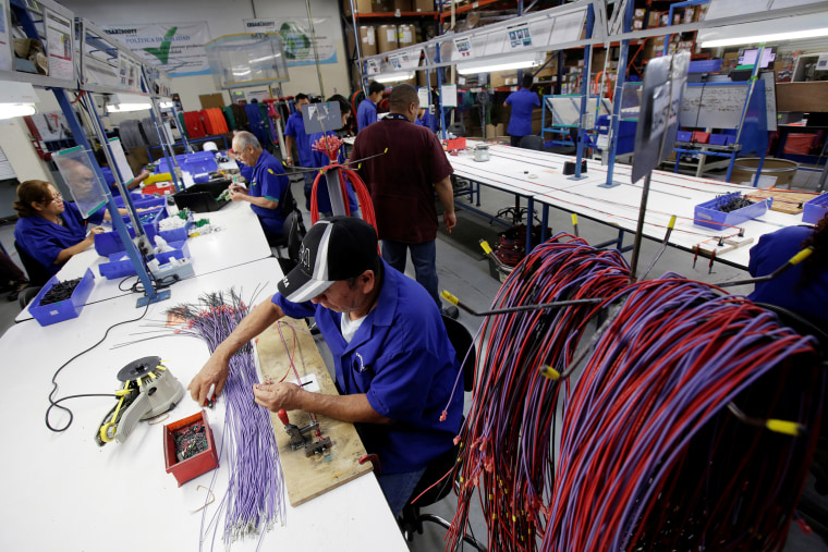 Employees work at a wire harness and cable assembly manufacturing company that exports to the U.S. in Ciudad Juarez