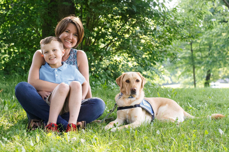 Amanda Swearingen and her son, Gavin, and his service dog, Elmer