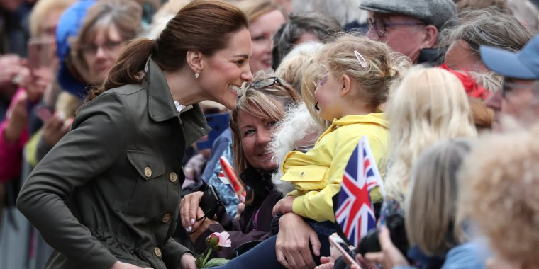 Britain's Prince William and Catherine, Duchess of Cambridge, arrive at Keswick Square in Cumbria, Kate Middleton combat boots
