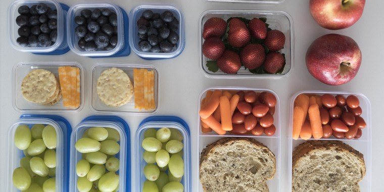 Overhead view prepared healthy snacks and lunches in containers