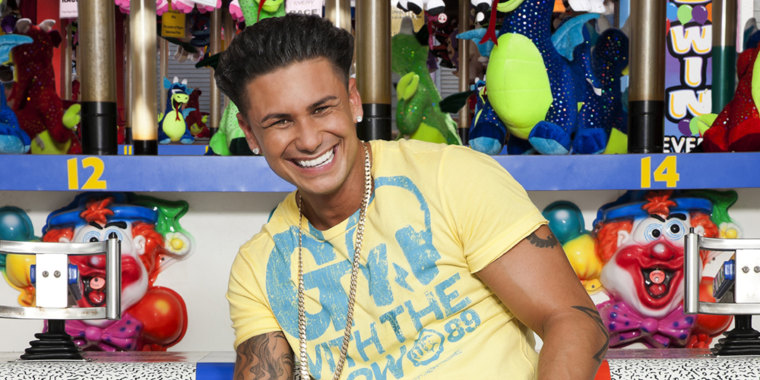 Pauly D puts down the hair gel for this summer picture