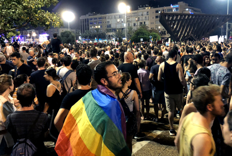 Image: Hen Mazzig at a rally for equal surrogacy rights in Tel Aviv on July 22, 2018.