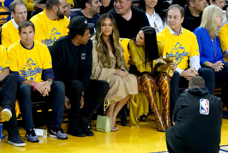 Image: Jay-Z and Beyonce sit next to Nicole Curran at the NBA Finals Game between the Golden State Warriors and Toronto Raptors in Oakland, California, on June 5, 2019.