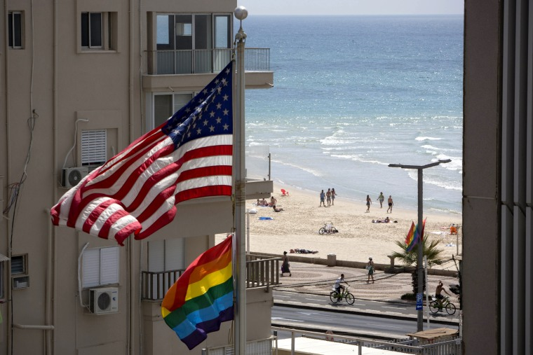 Image: A United States flag flies alongside a pride flag at the U.S. Embassy in Tel Aviv, Israel, in 2014.