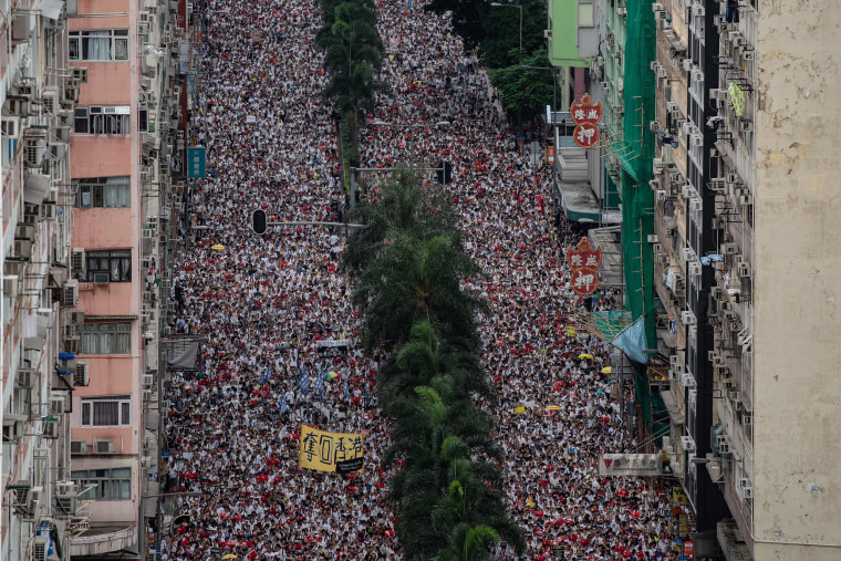 Image: Protesters march during a rally against a controversial extradition law proposal in Hong Kong
